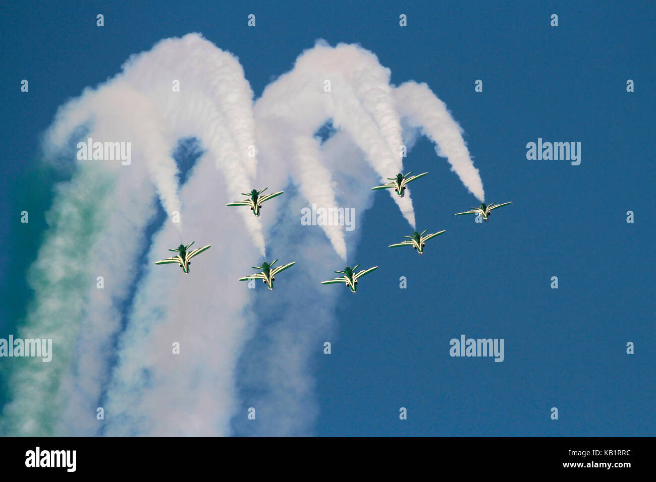 The Saudi Hawks aerobatic display team of the Royal Saudi Air Force performing a formation loop - Stock Image