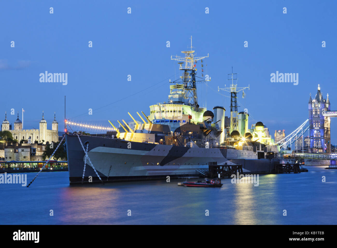 England, London, Southwark, war museum, was illuminated Imperial museum, warship Belfast HMS, in the evening, - Stock Image