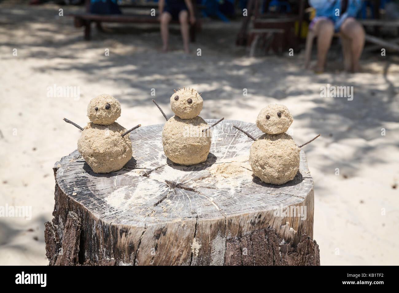 Three sand men on a beach in Kota Kinabalu Malaysia - Stock Image