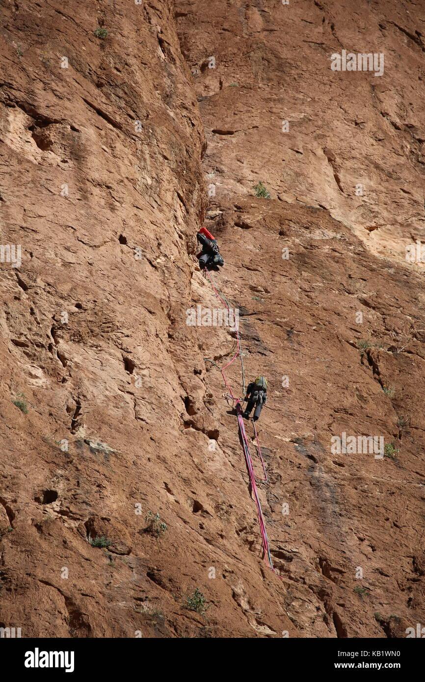 Climber at a rock in Morocco --- Bergsteiger an einem Felsen in Marokko - Stock Image