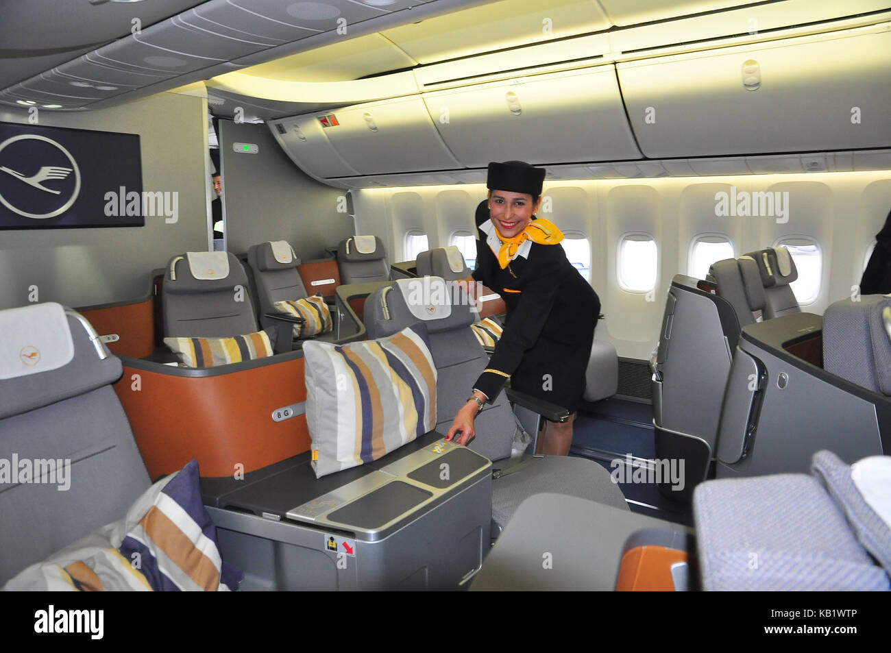 Civil aviation, air liner, cabin, business class, stewardess, - Stock Image