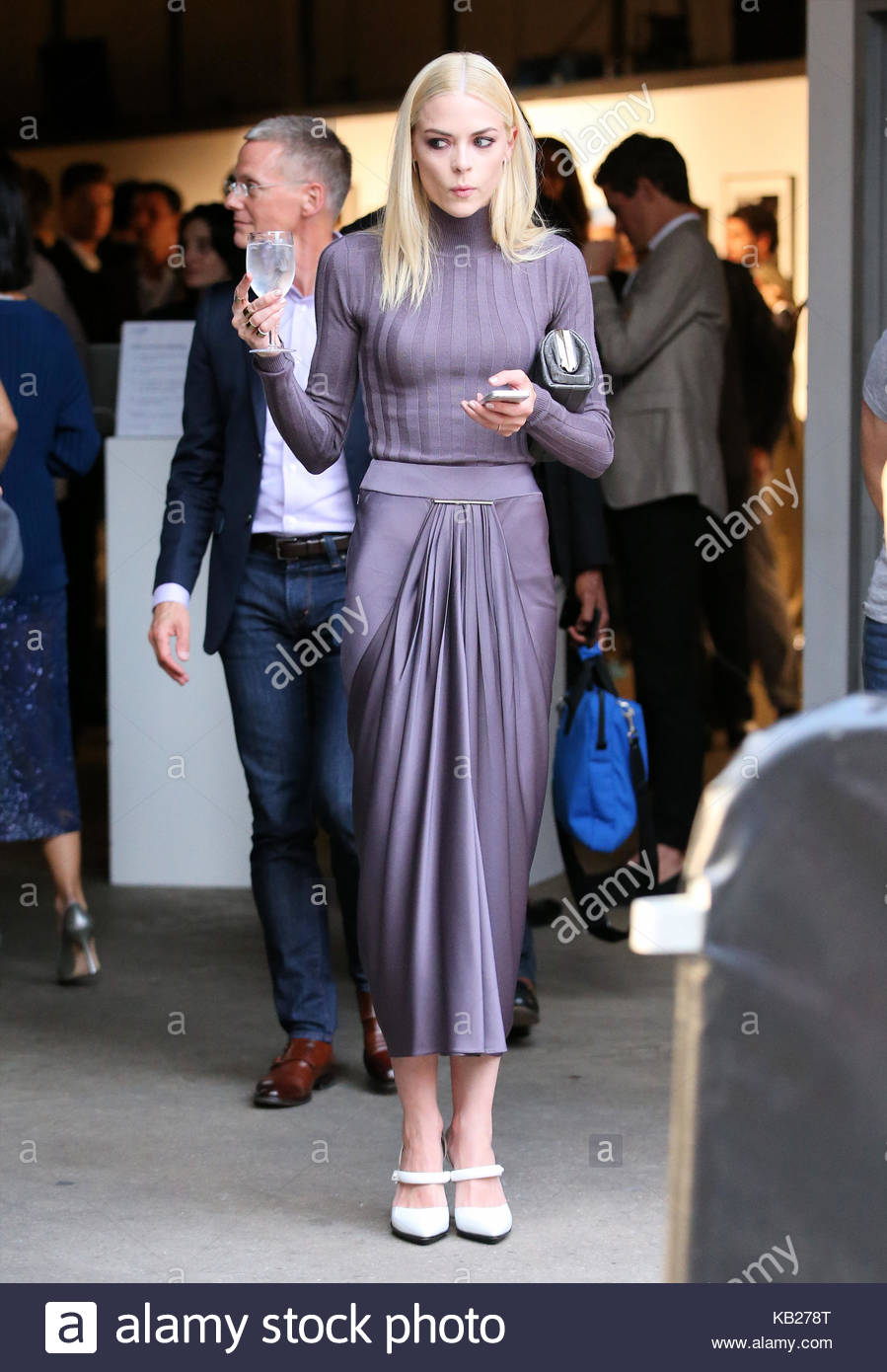 Jaime King. Actress Jaime King, wearing a purple evening gown, holds ...