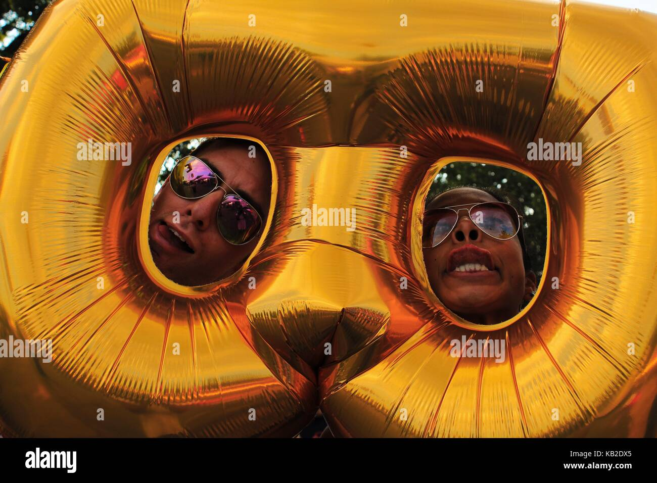 Silly Faces in a balloon - Stock Image
