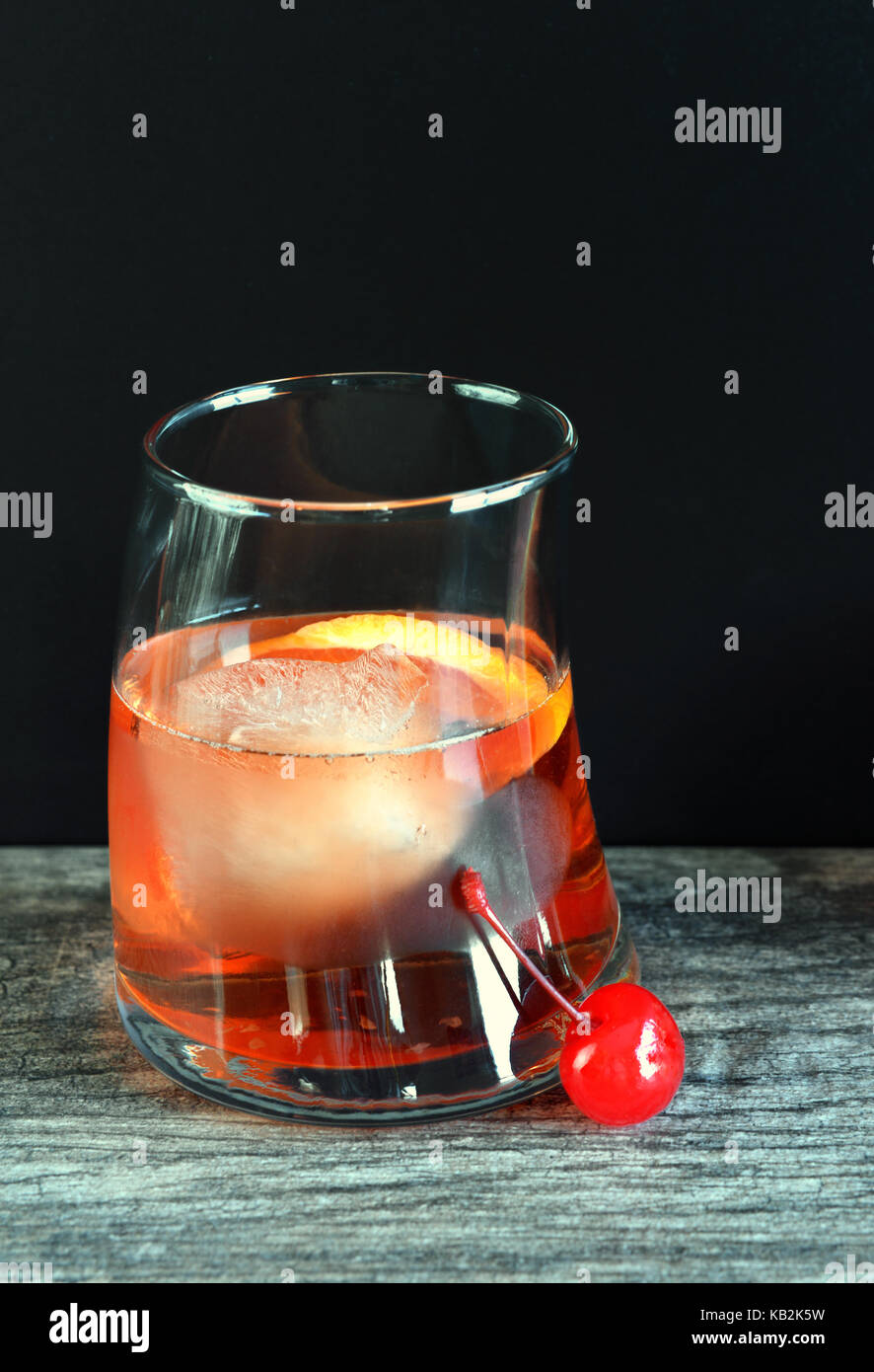 Old Fashioned Cocktail with Ice in Glass - Stock Image