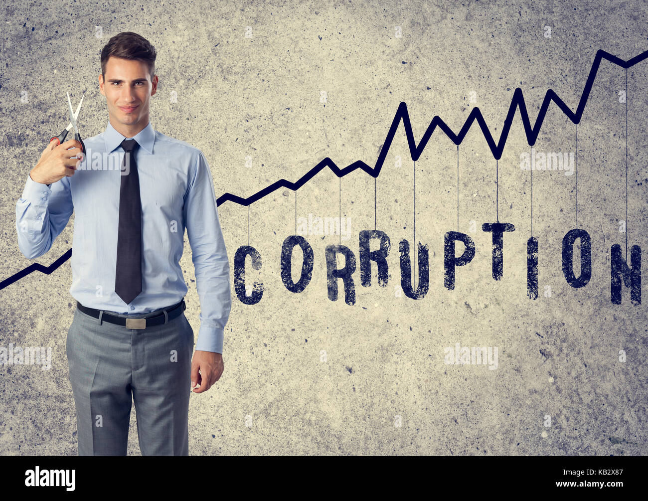 cut corruption  - young businessman with scissors anti corruption - Stock Image
