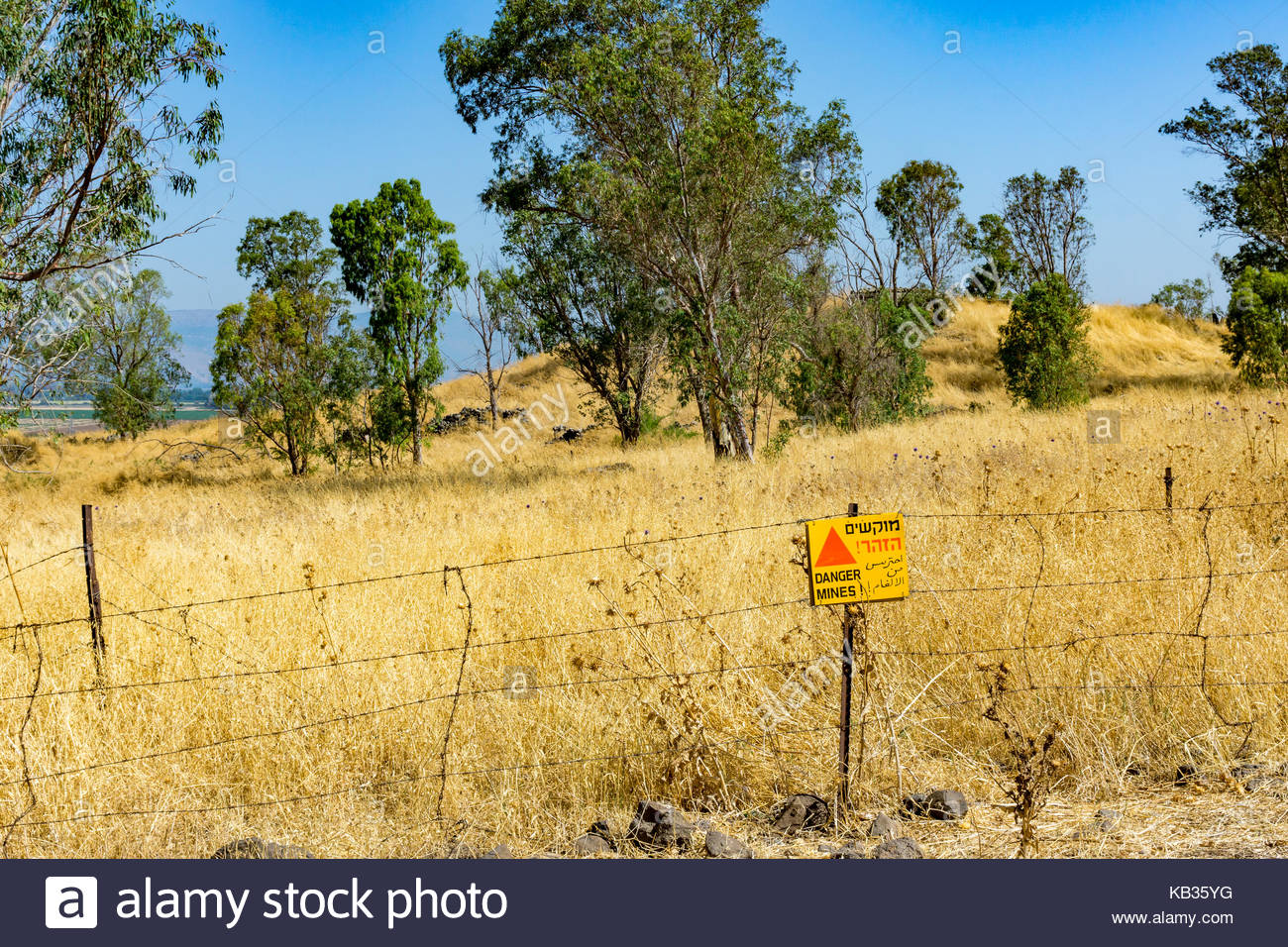A Sign Warns Of Uncleared Mines In The Golan Heights Israel A Syrian Bunker From The 6 Day War Is In The Background