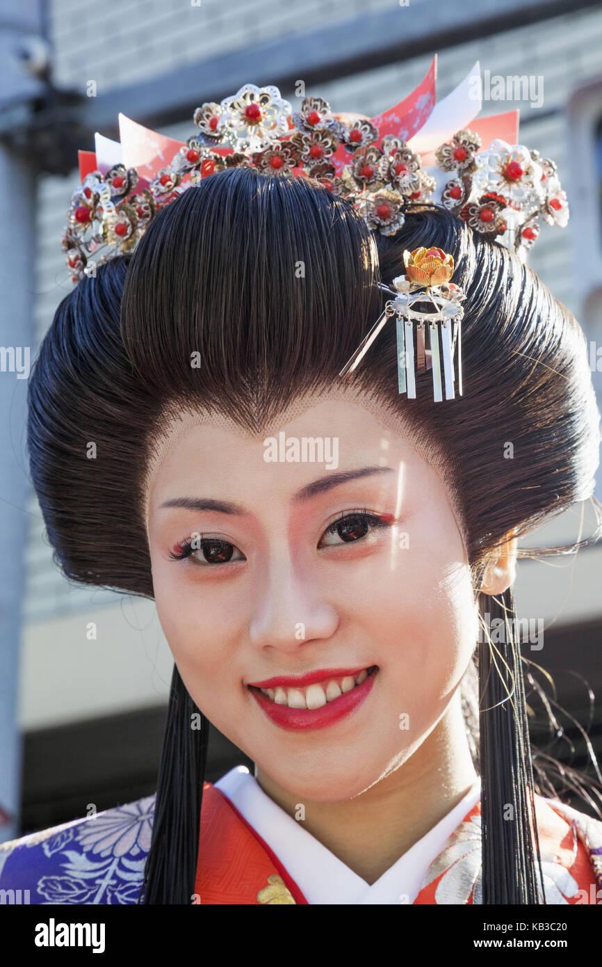 Japan, Honshu, Tokyo, Asakusa, Jidai Matsuri festival, participant in traditional kimono, Stock Photo