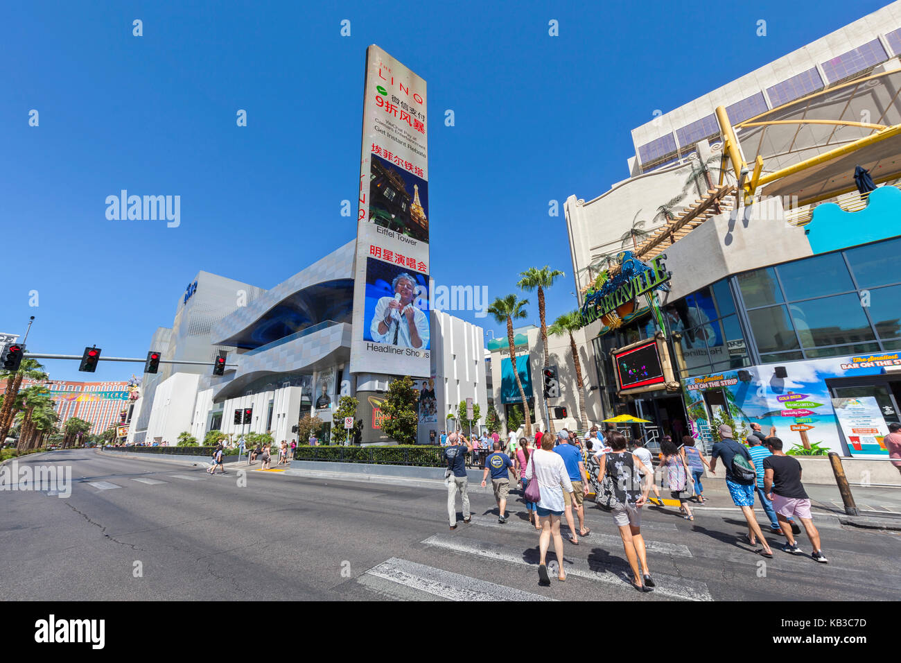 Tourists cross the Las Vegas Blvd in Las Vegas, Nevada. - Stock Image