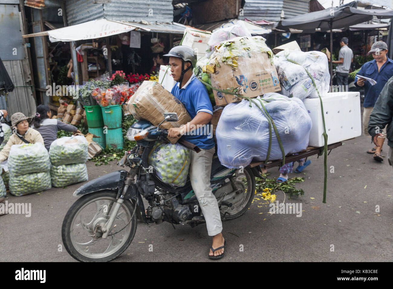 Vietnam, Nha Trang, central market Cho Dam, man carries goods on fully charged motorbike, - Stock Image