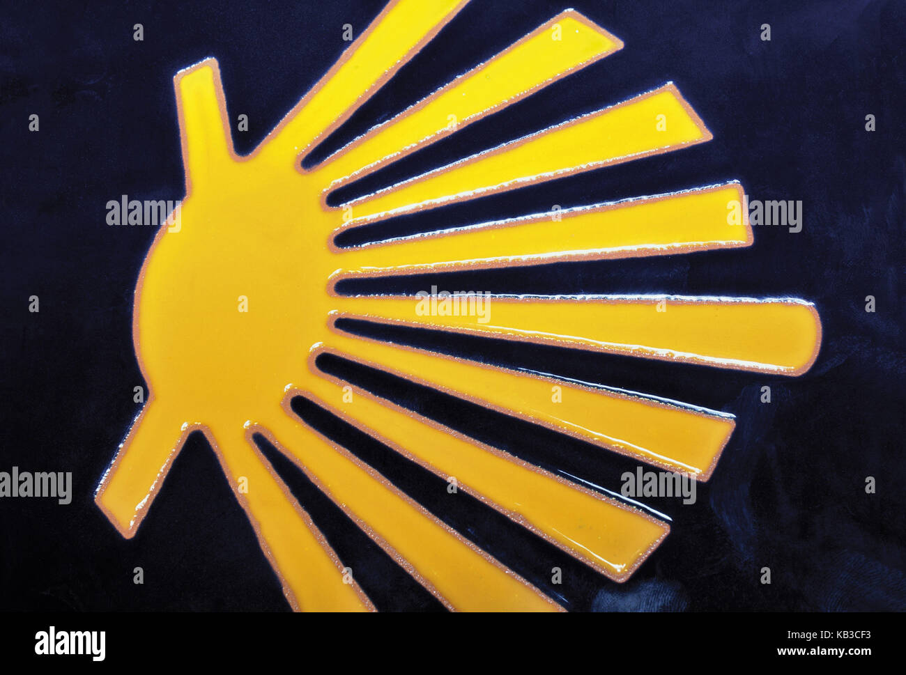 Spain, Way of St. James, yellow scallop shell on blue ground, icon of the Way of St. James, - Stock Image