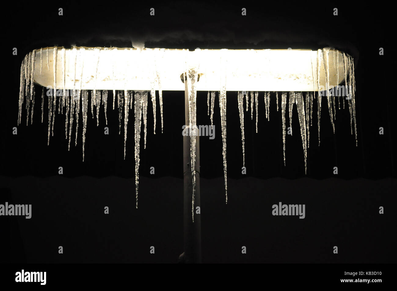 Street lamp, darkness, icicle, - Stock Image