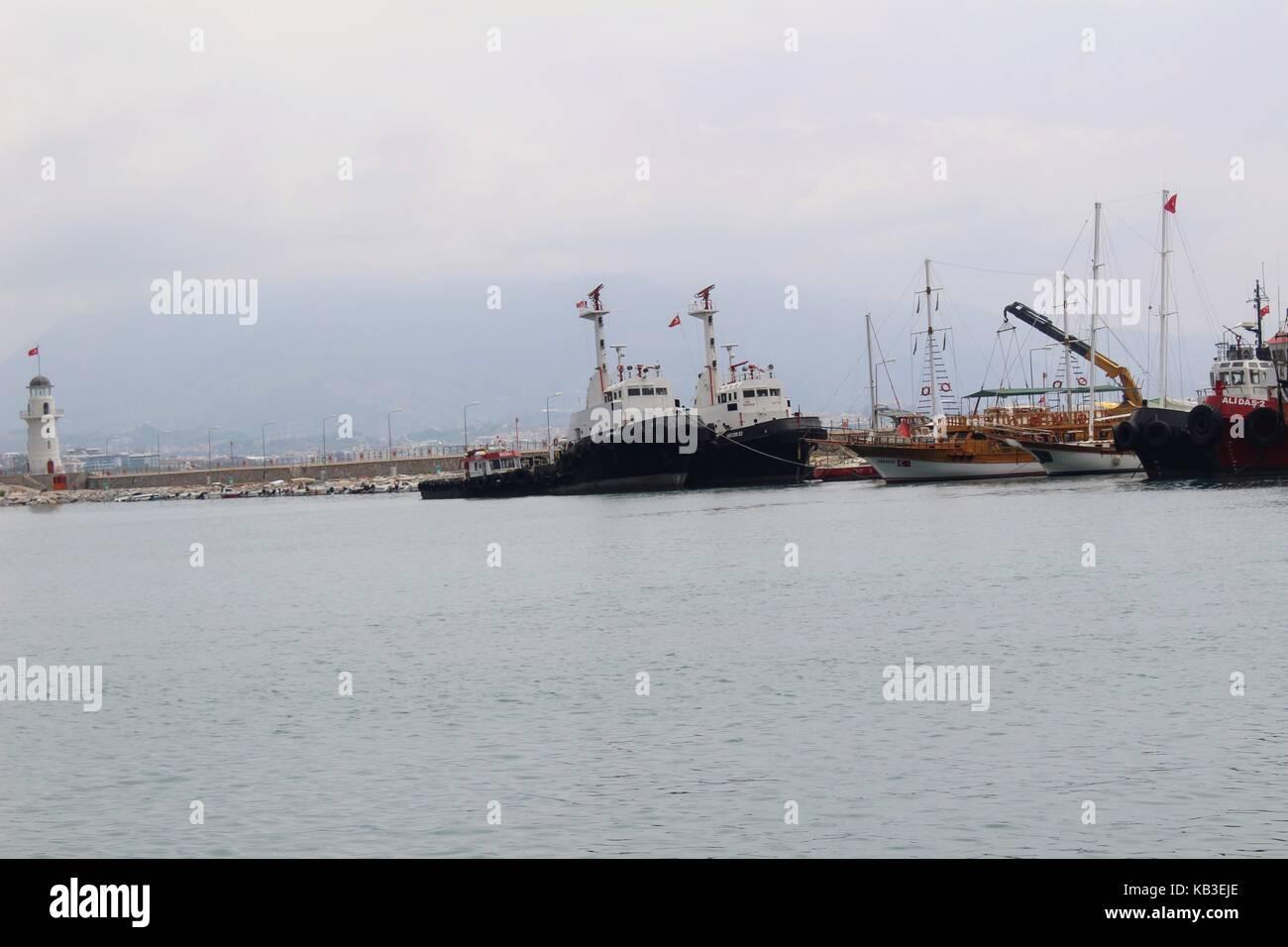 Sea tugs anchored in the city harbor (Antalya, Turkey) in July 2017. - Stock Image
