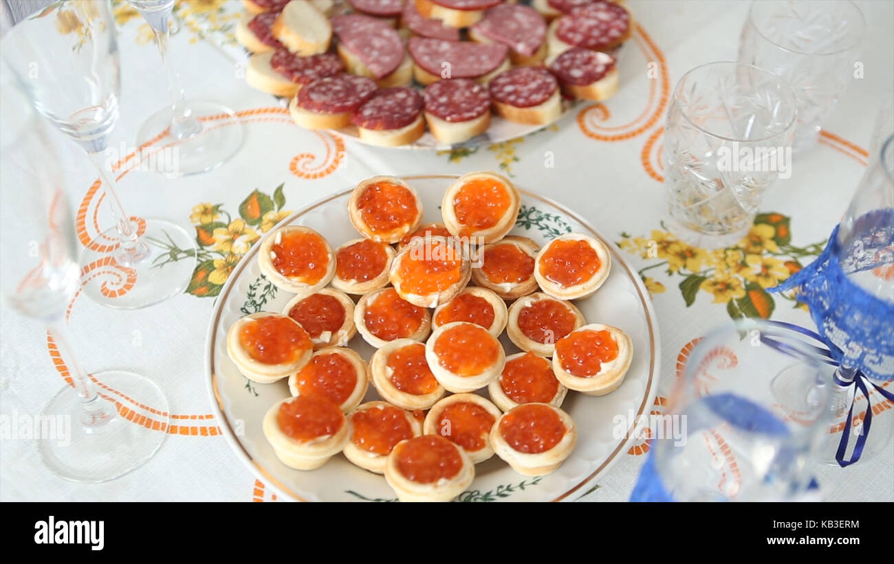 Caviar canape' on luxury table. Red Caviar And Fish Strawberries On Table. Wedding - Stock Image