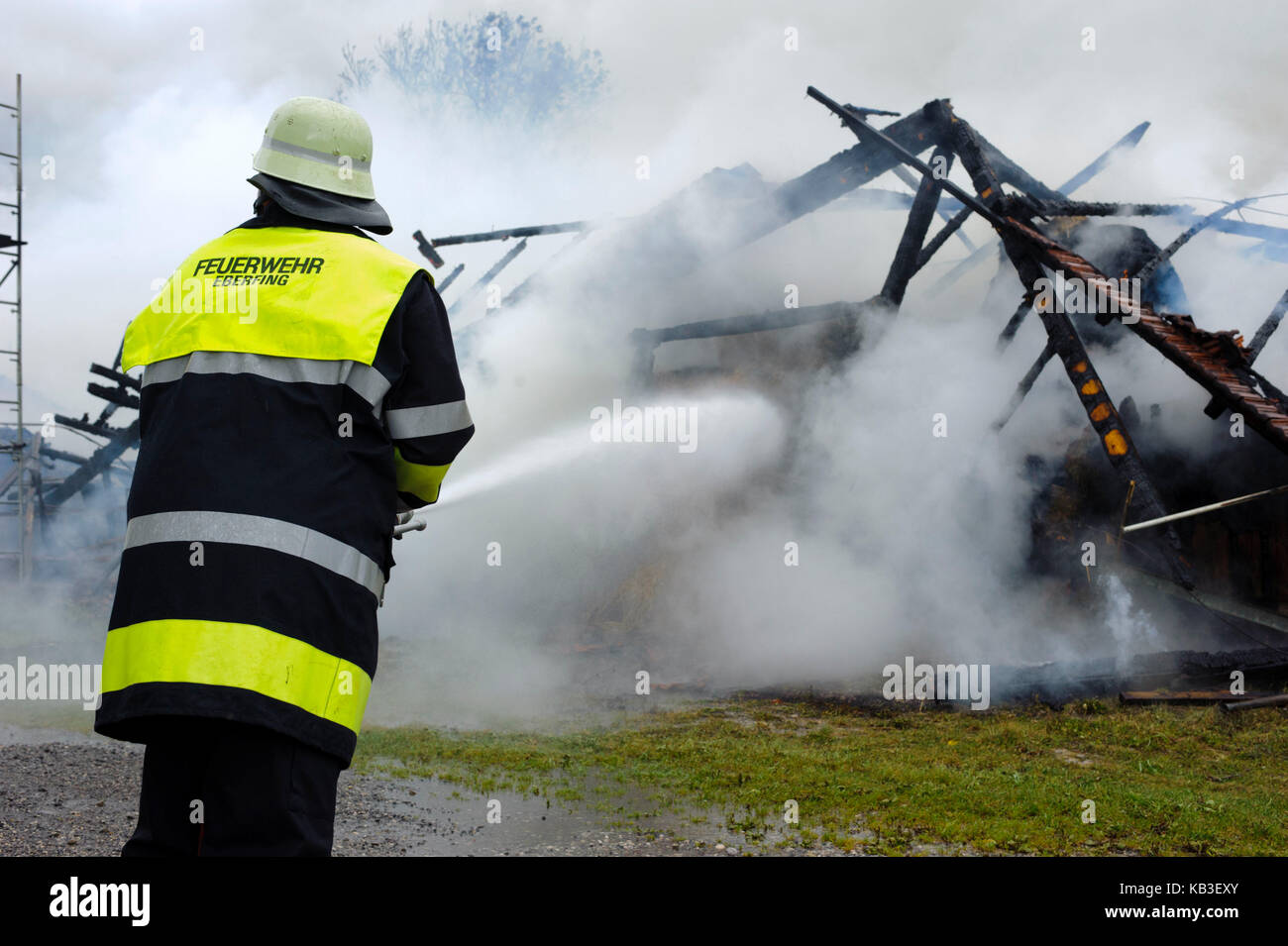 Conflagration in Eberfing near Weilheim, Bavaria, fire of an agricultural building is deleted by a major operation - Stock Image