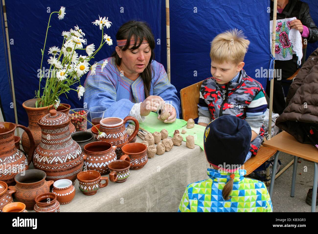 June, 2017, Odoev (Russia): Folk Festival 'Grandfather Filimon's Tales' - master class on modeling clay - Stock Image