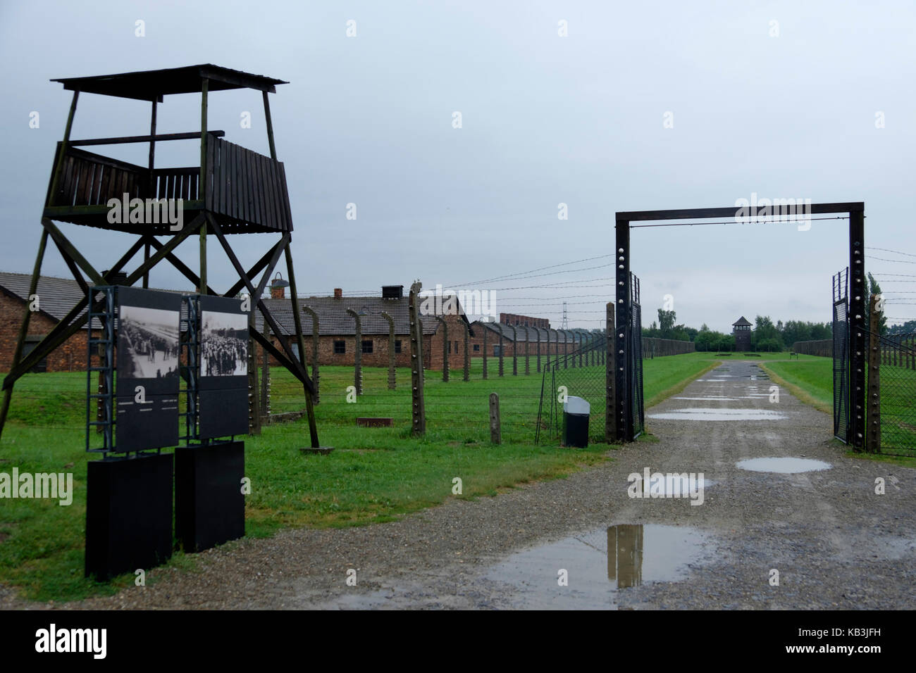 Watchtower and barracks at Auschwitz II Birkenau concentration camp, Poland - Stock Image