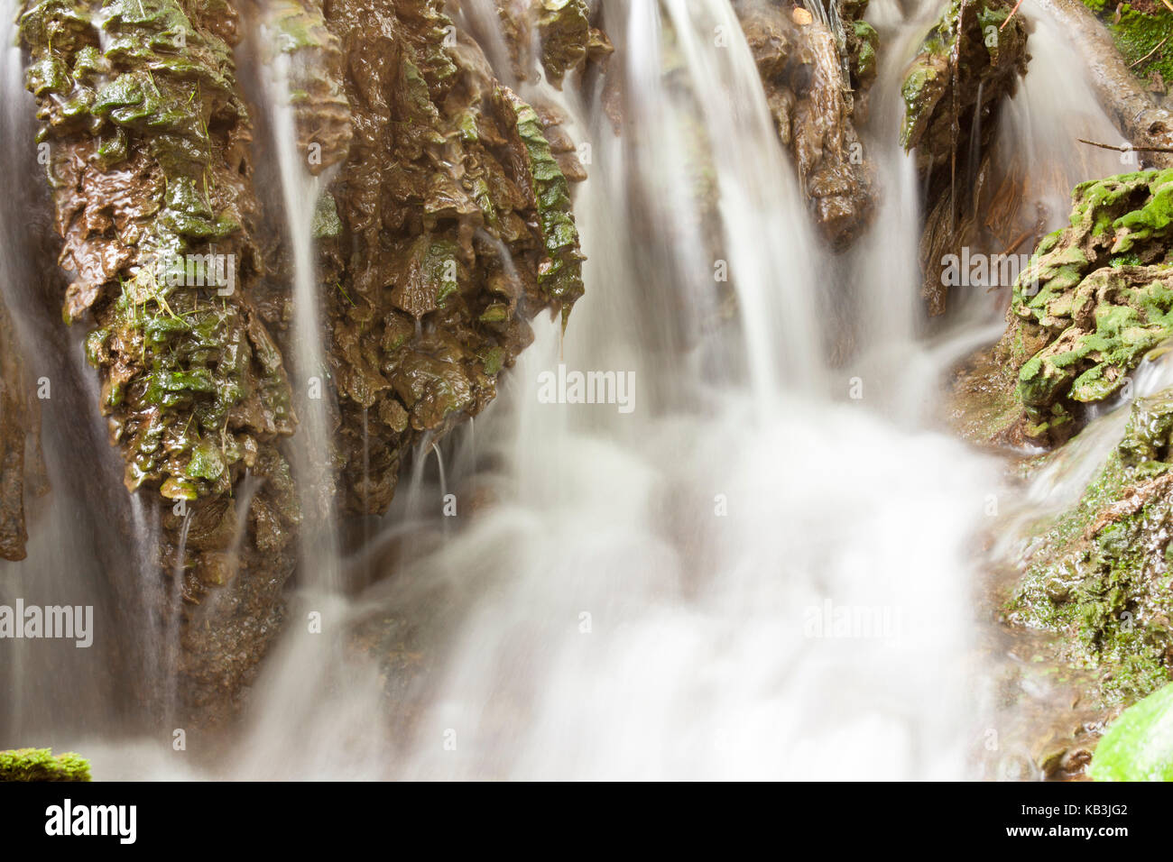 Stream blurred water in small waterfall - Stock Image