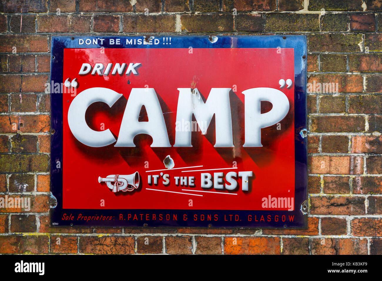 Vintage enamel Drink Camp (coffee) sign at East Sussex Railway heritage steam railway, Tenderden Town Station, Kent, - Stock Image
