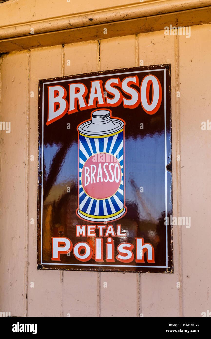 Vintage enamel Brasso Metal Polish sign at East Sussex Railway heritage steam railway, Tenderden Town Station, Kent, - Stock Image