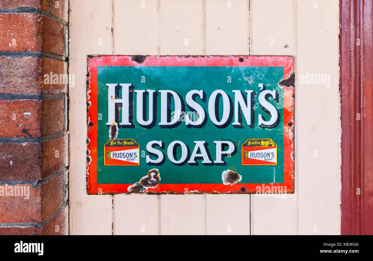 Vintage enamel Hudson's Soap sign at East Sussex Railway heritage steam railway, Tenderden Town Station, Kent, - Stock Image