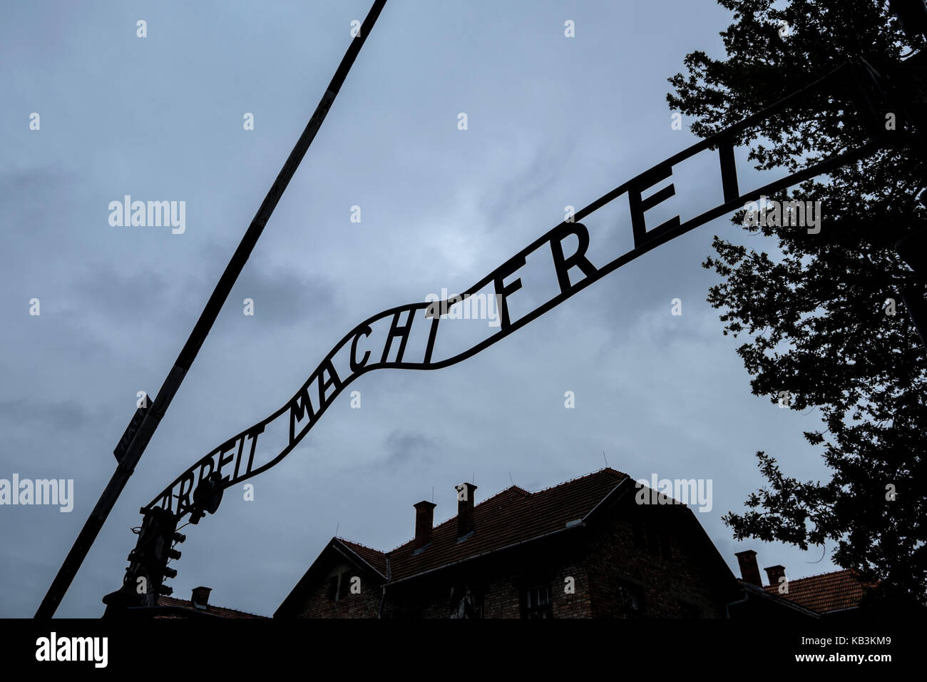 Arbeit Macht Frei sign at the entrance gate of Auschwitz WWII Nazi concentration camp, Poland - Stock Image