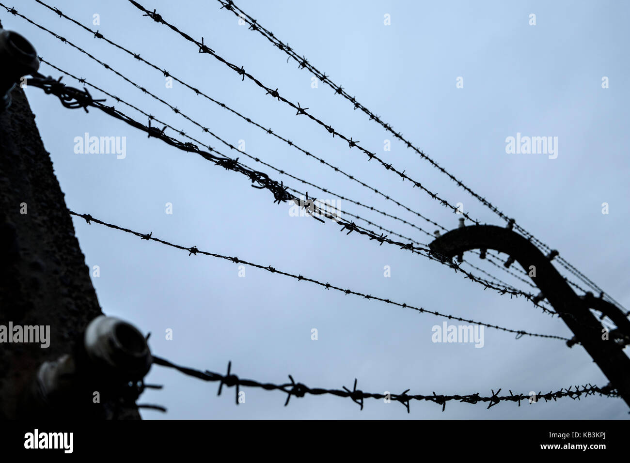 Barbwire fences in Auschwitz II Birkenau concentration camp, Poland - Stock Image