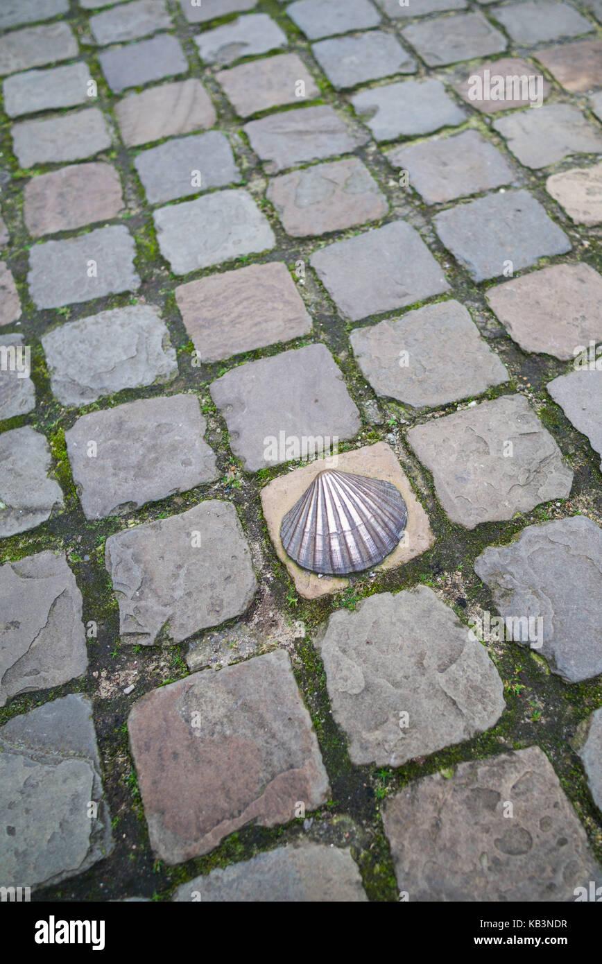 Belgium, Bruges, bronze seashell marking of the Camino de Santiago religious pilgrimage route - Stock Image