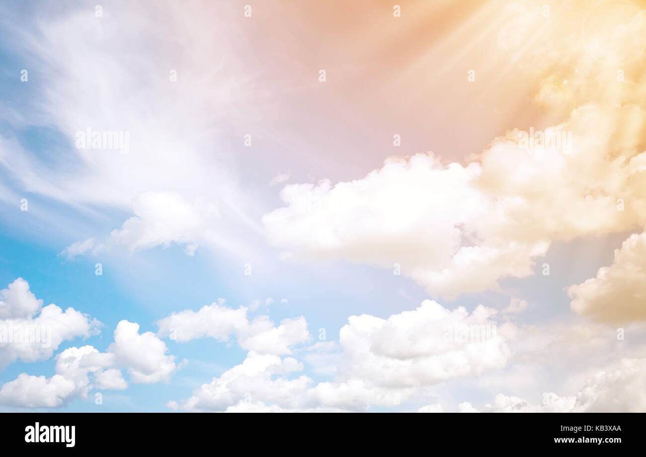White fluffy clouds and sun background. - Stock Image