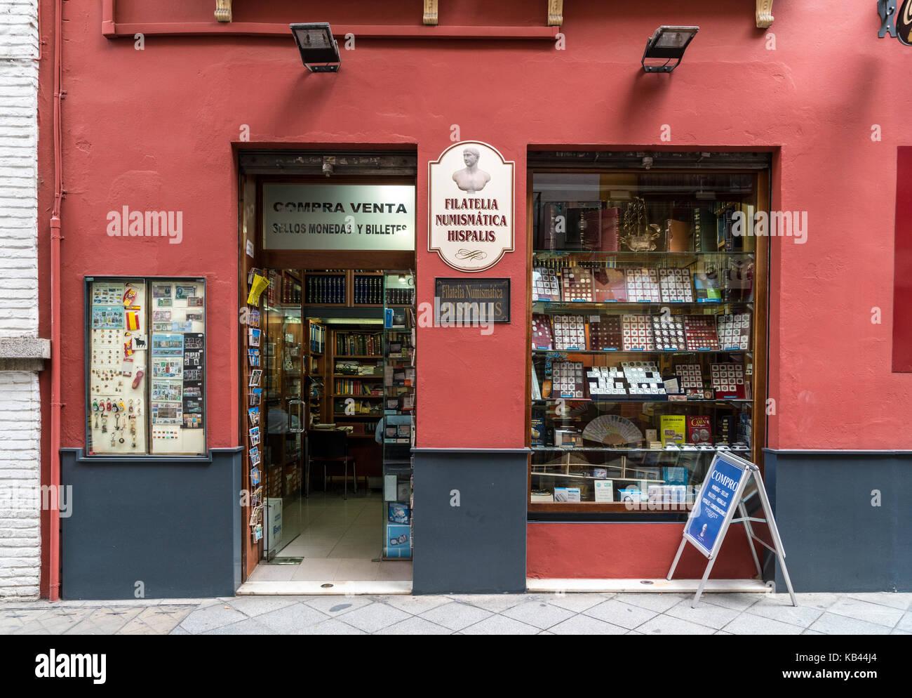 Philatelic and numismatic shop in Barrio de Santa Cruz of Seville, Spain - Stock Image