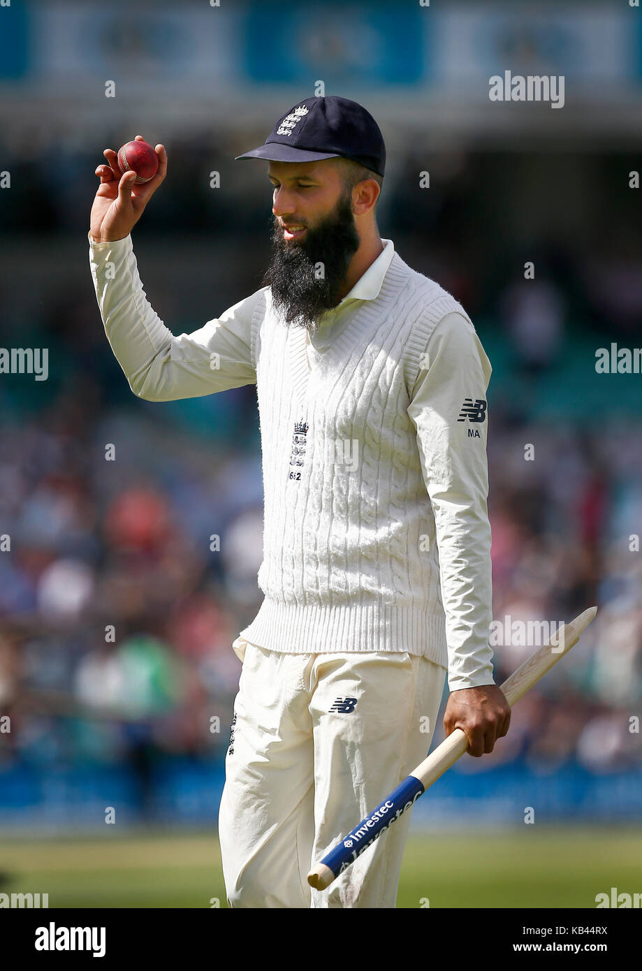 4af92e98 Moeen Ali of England comes off the field after taking a hat-trick during day