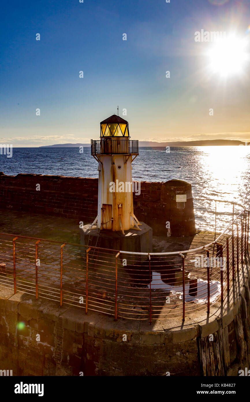 Lighthours  at entrance to Brodrick harbour, Isle of Arran, Scotland. - Stock Image