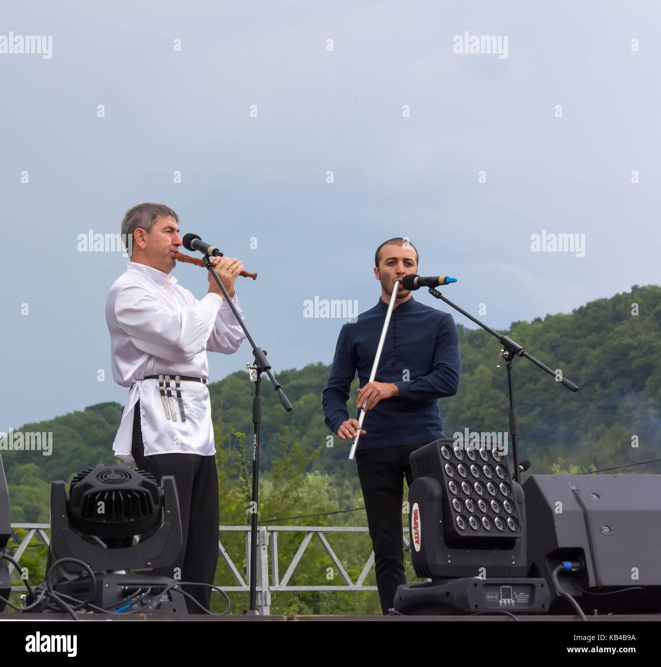 Adygea, Russia - August 19, 2017: the mans on the stage plays the Adyghe traditional musical instrument Kamyl and - Stock Image