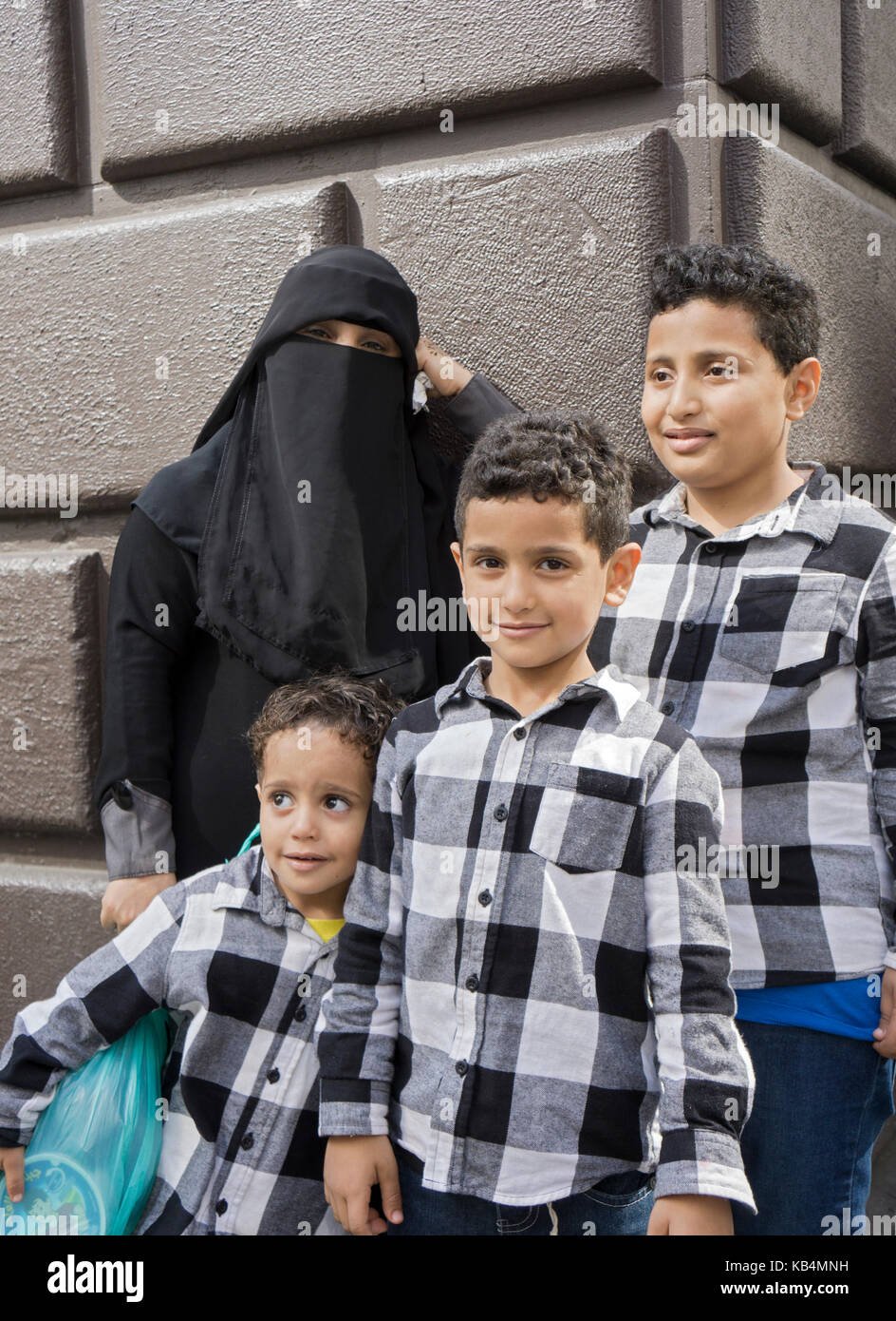 A woman from Yemen and her three sons wearing identical shirts at he Muslim Day Parade in Midtown Manhattan, New - Stock Image