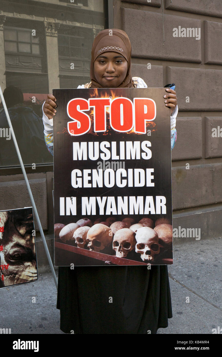 A young American Muslim protesting the genocide in Myanmar at he Muslim Day Parade in Midtown Manhattan, New York - Stock Image