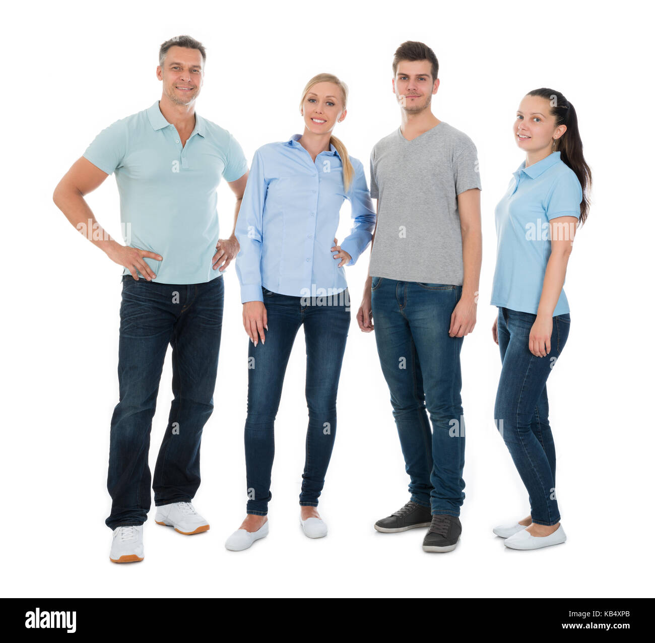 Group Of Happy People In Casual Standing Over White Background - Stock Image