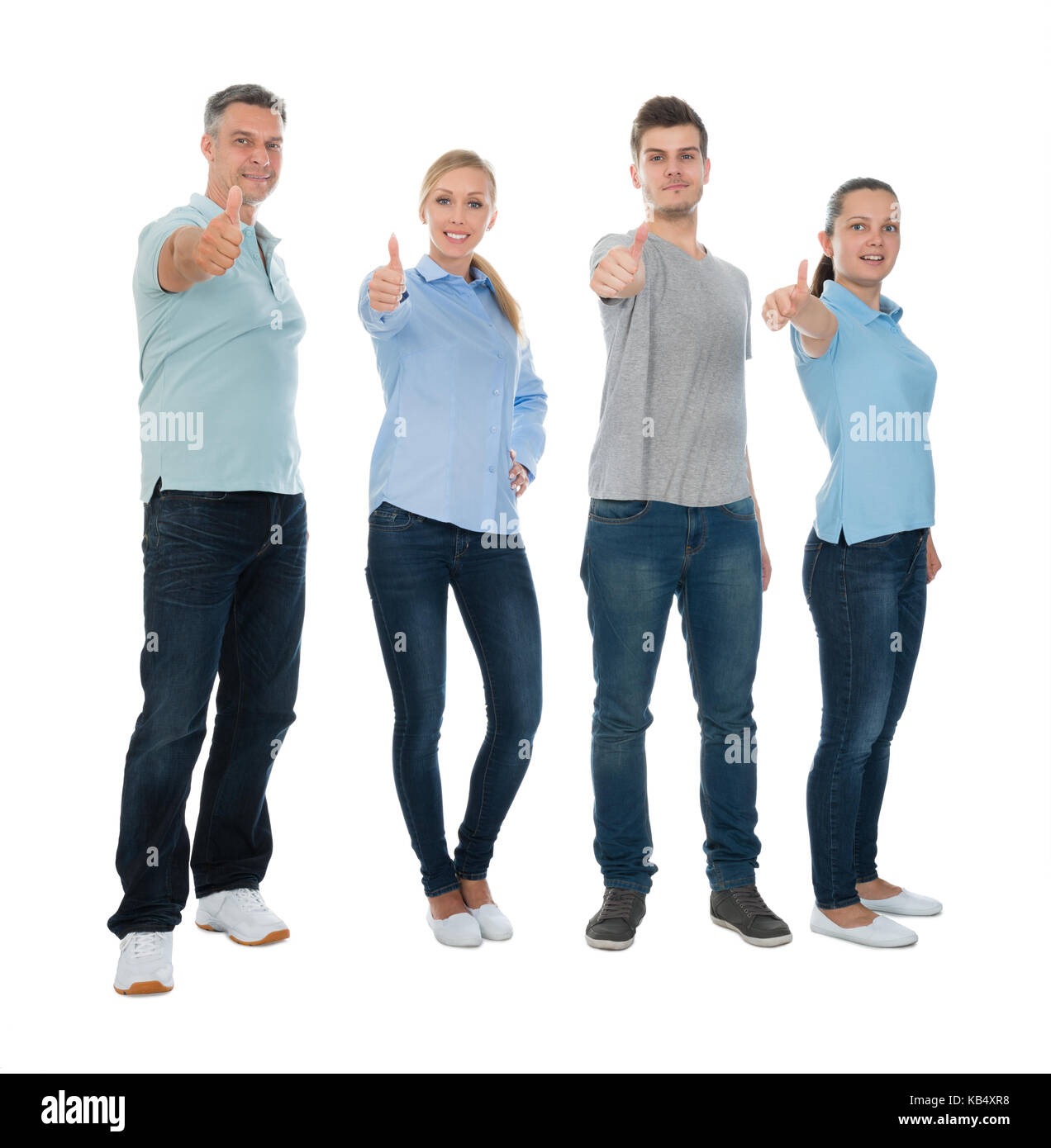 Group Of Happy People Showing Thumb Up Sign Over White Background - Stock Image