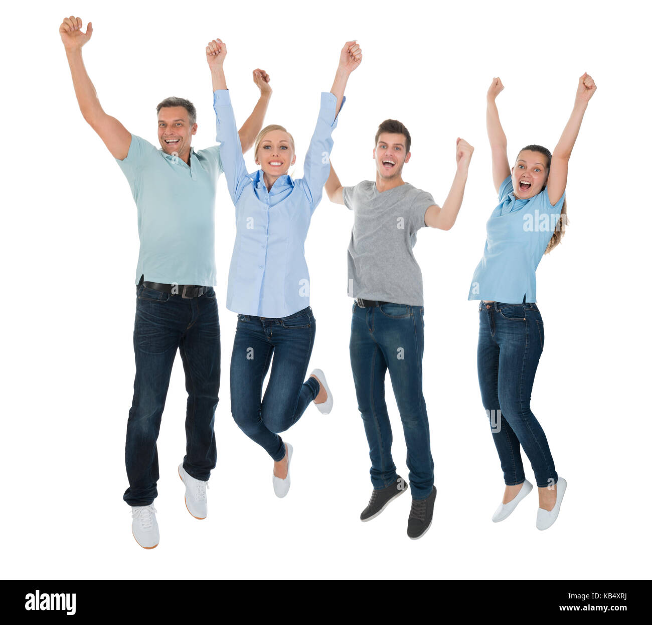 Group Of Excited People Jumping Over White Background - Stock Image