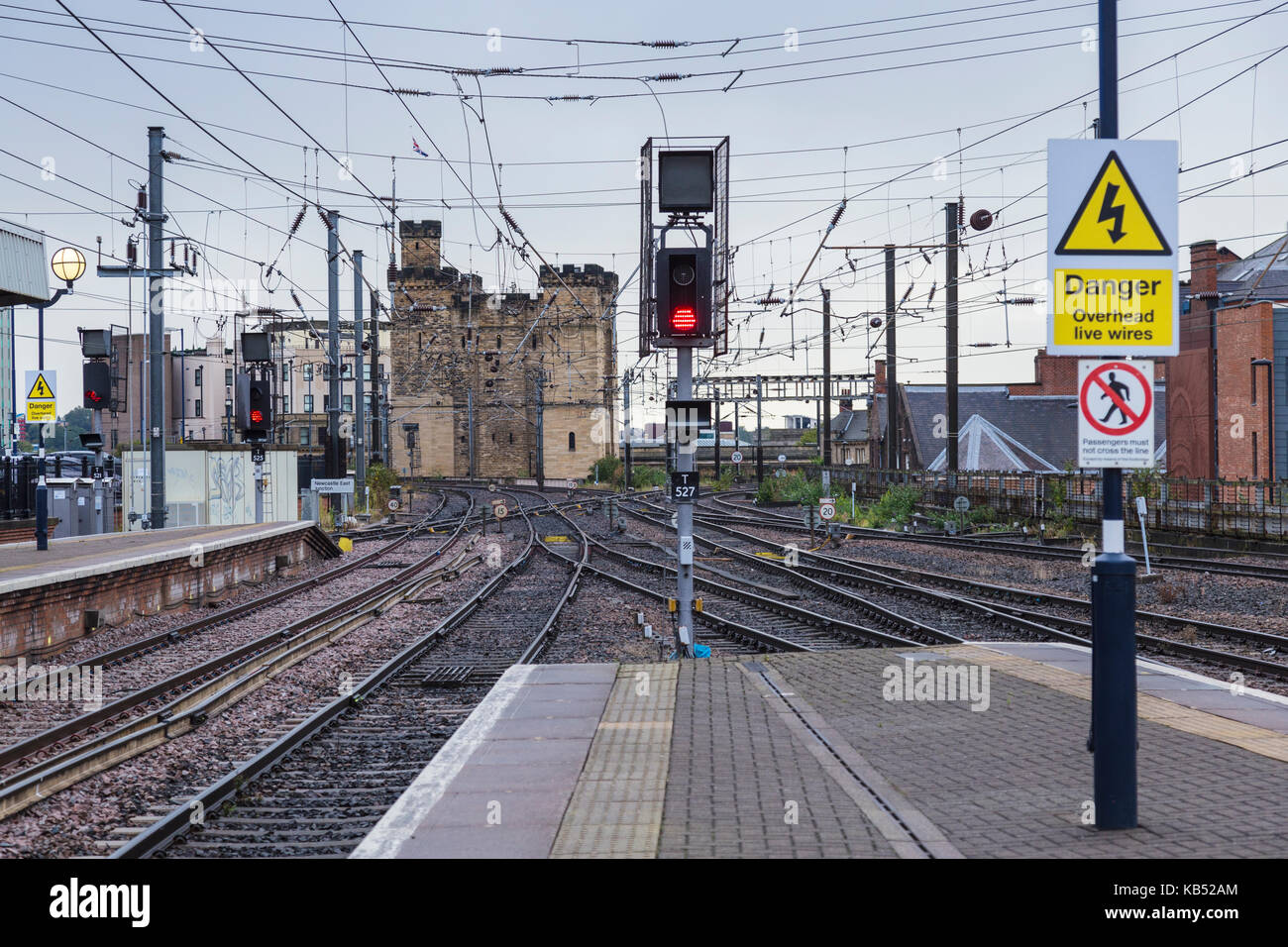 North End of Newcastle Central Station with Red Signal and Newcastle Castle in the Background - Stock Image