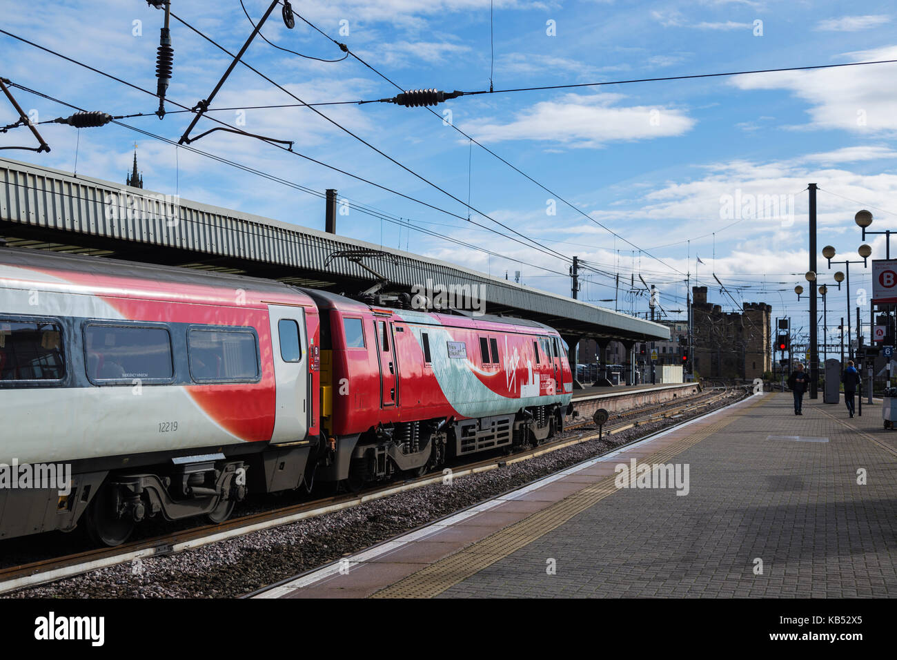 Class 91 Electric Locomotive About to Depart Newcastle Central Station for Scotland with Newcastle Castle in the - Stock Image