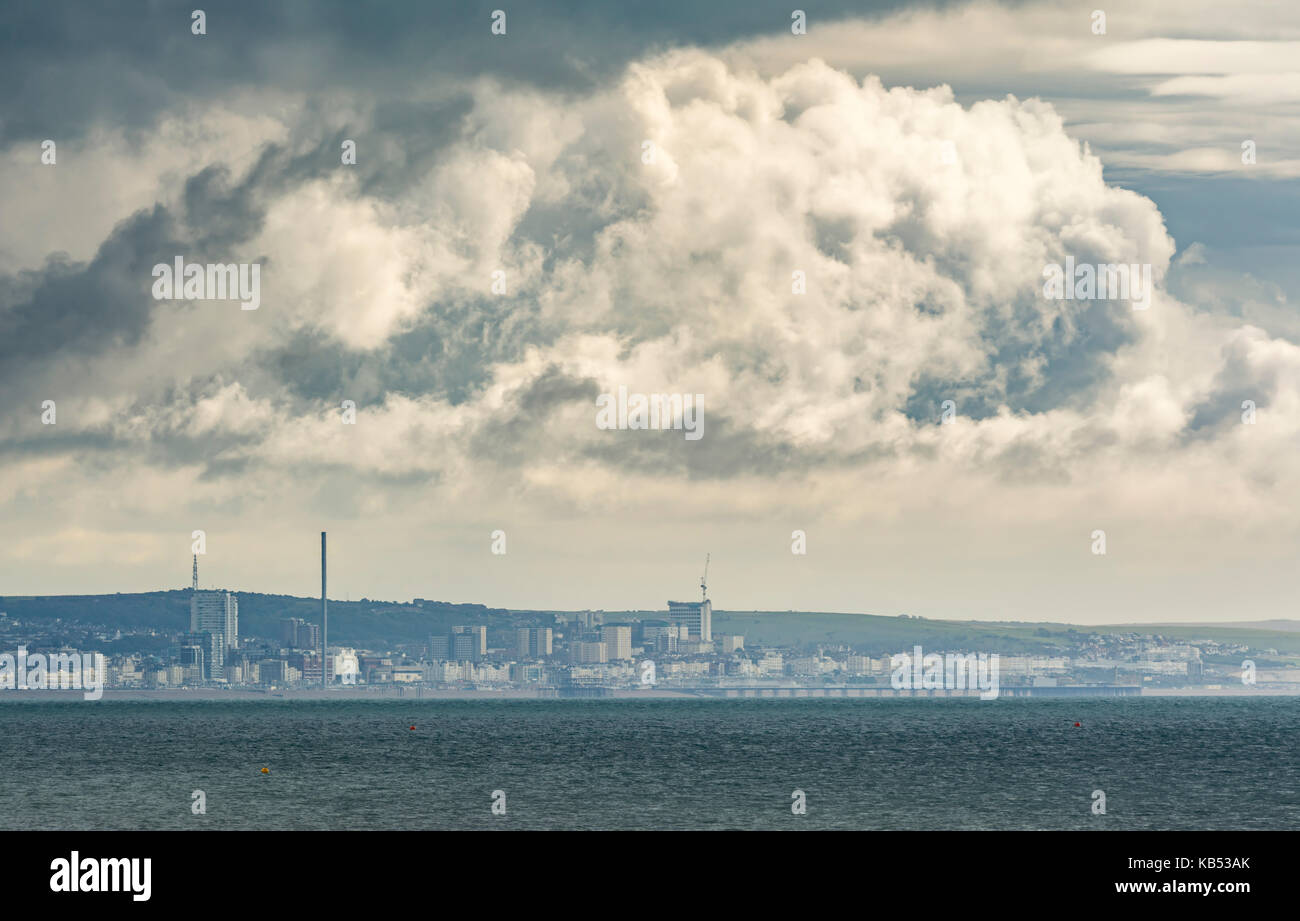 Brewing storm clouds developing over the sea on the south coast in the UK. - Stock Image