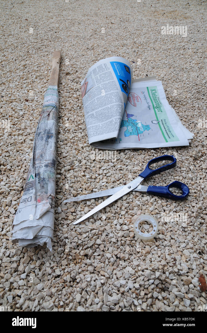 handicraft instruction, step by step, build torches by yourself, picture series with text - Stock Image