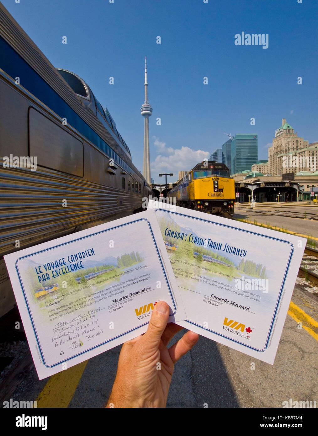 hand holds Train certificates Stock Photo