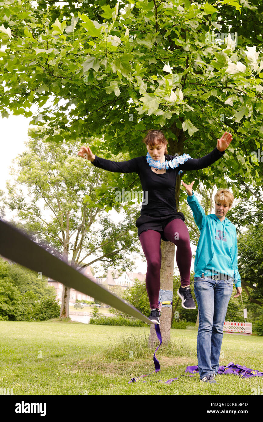 Girlfriends at a bachelorette party, fun, Slacklining - Stock Image