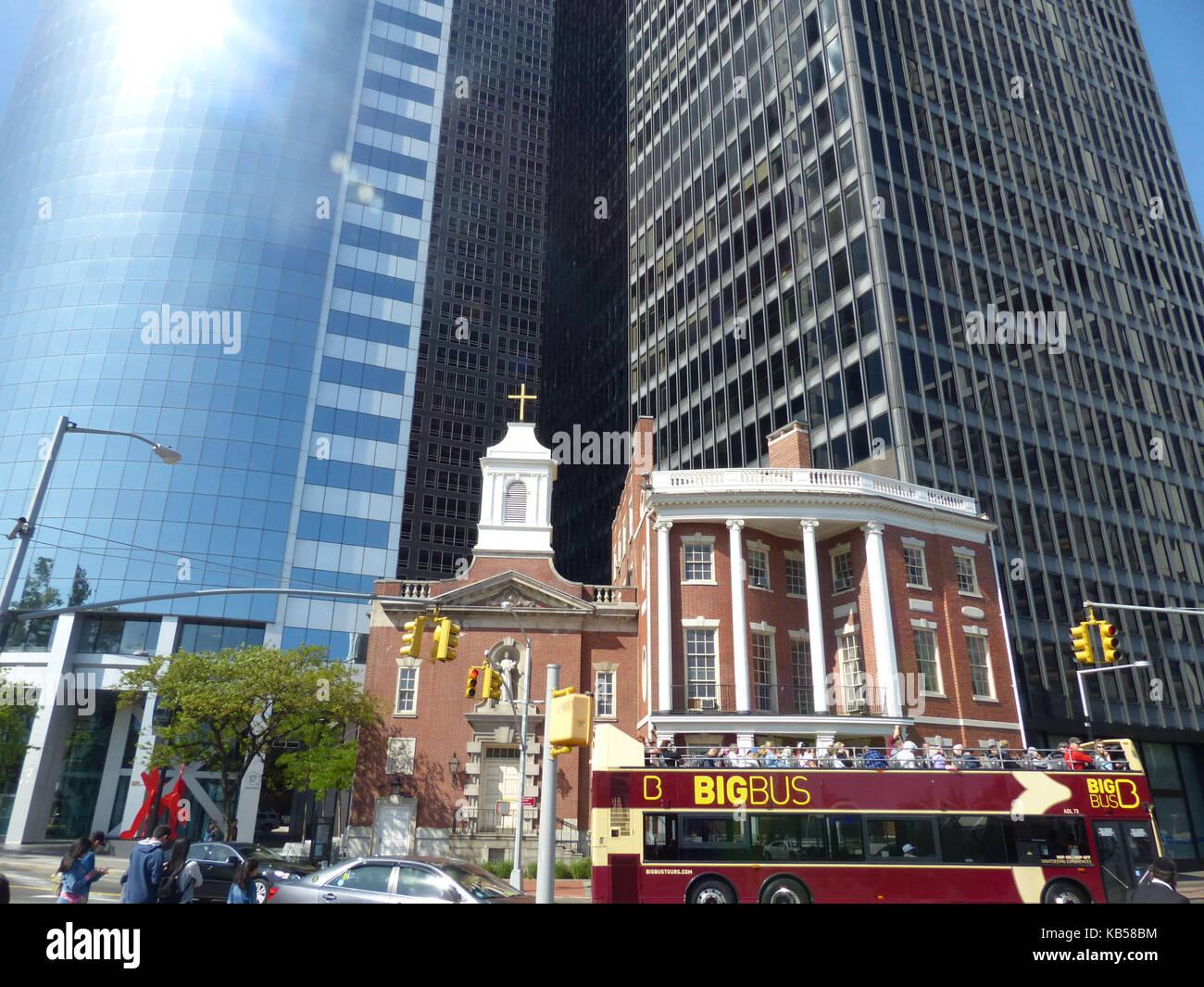 Old and New New York. Saint Elizabeth Ann Seton Shrine (centre) juxtaposing to #17 State Street office tower designed - Stock Image