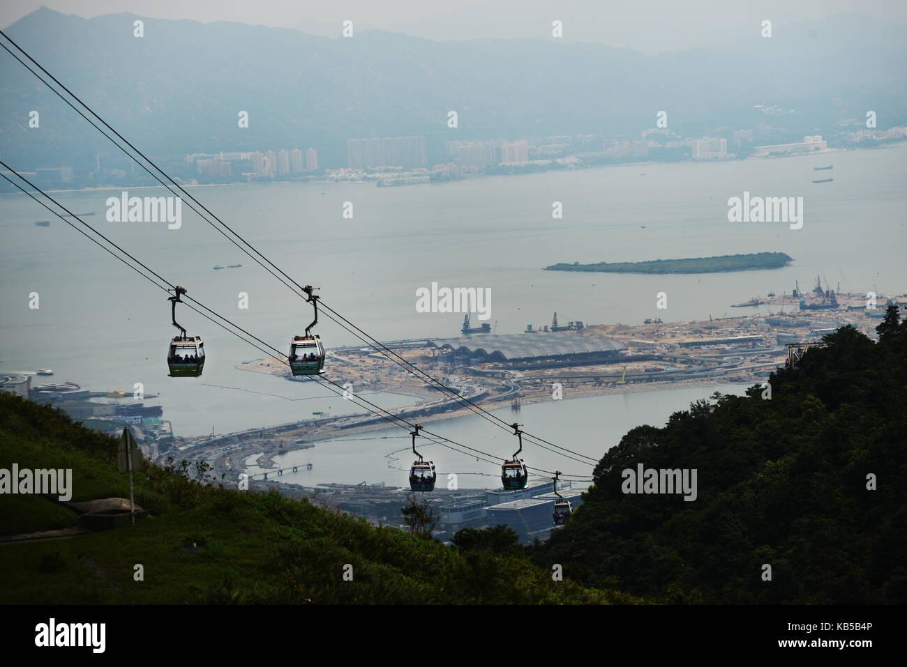 The Ngong Ping 360 is a gondola lift to the Tian Tan big Buddha park in Lantau island. - Stock Image