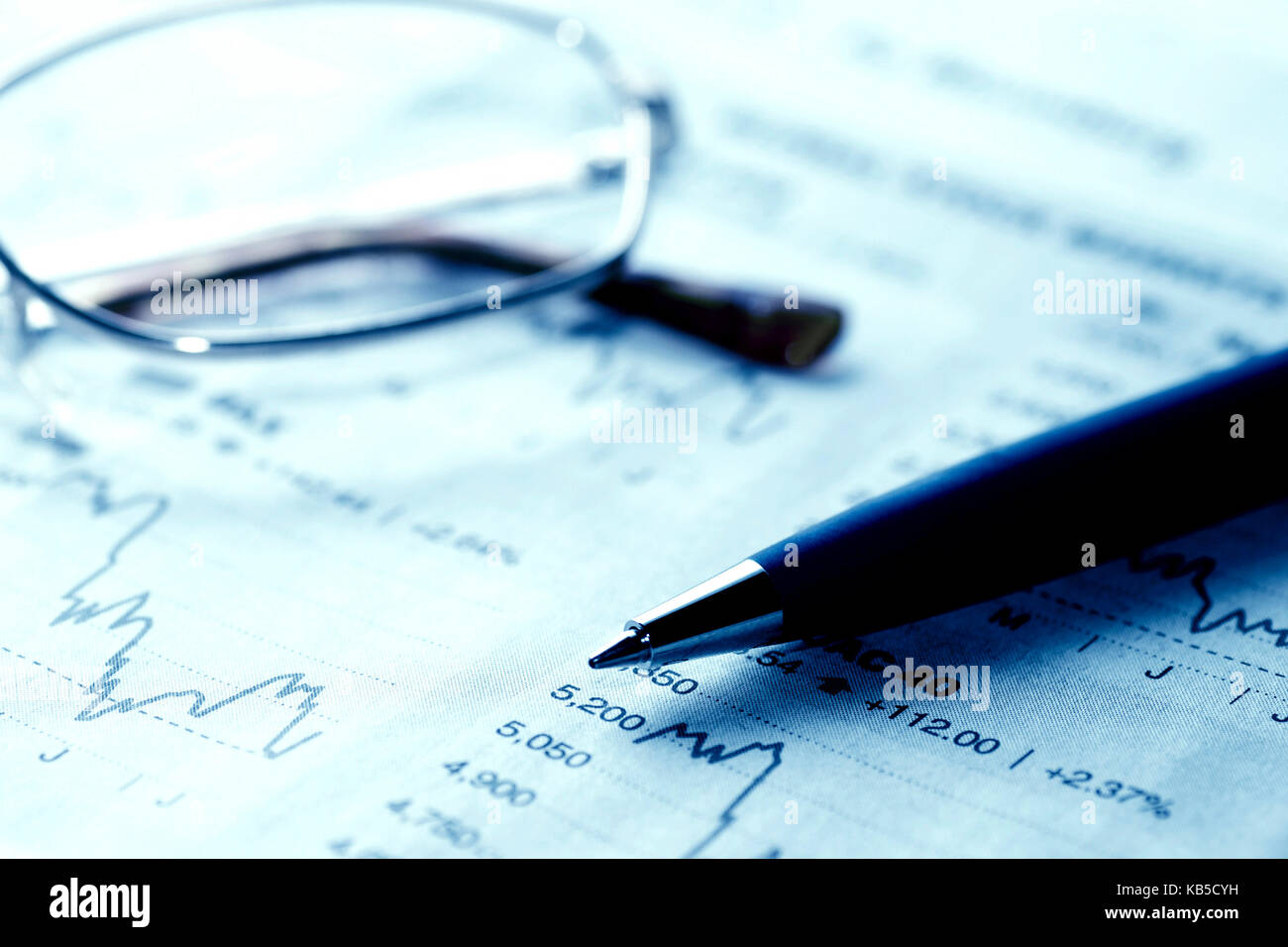 financial graph and pen, stock markets concept - Stock Image