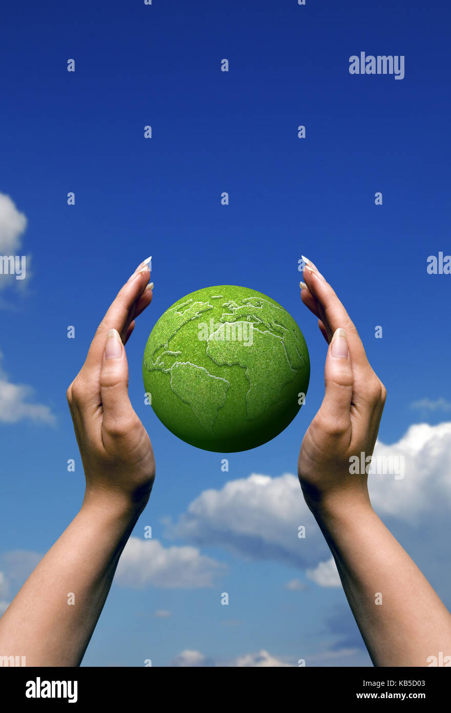 female hands around a green earth globe, protecting our planet and ecology concept - Stock Image