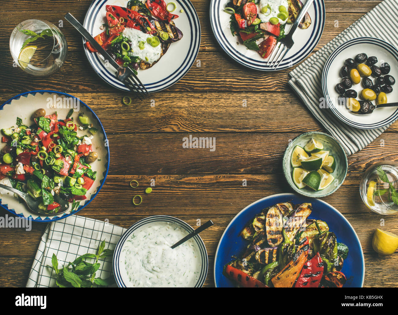 Flat-lay of healthy dinner table setting with vegetarian appetizers Stock Photo