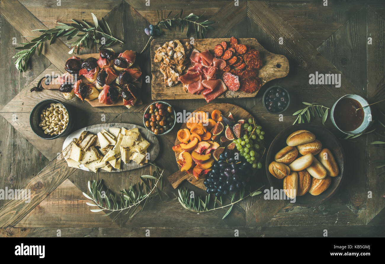 Flat-lay of holiday, party, family dinner table set with snacks - Stock Image