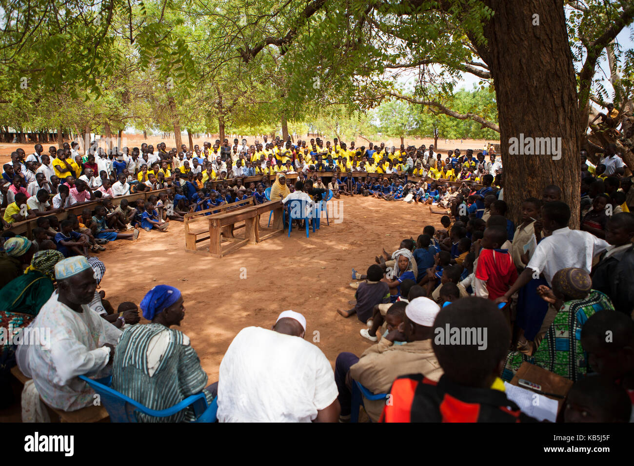 Students at a junior High School watch a play about teenage pregnancy put on by the schools Gender Club, Ghana, - Stock Image